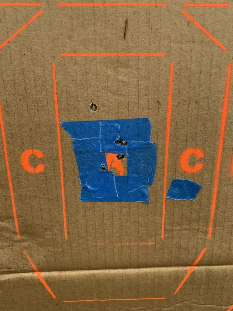 Outside of the tape was a previous shot, the four shot group was my final sight in group at 50 yards!